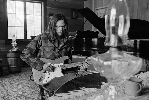01 Jun 1973, Probably California, USA --- Neil Young Playing Guitar --- Image by  © Henry Diltz/CORBIS